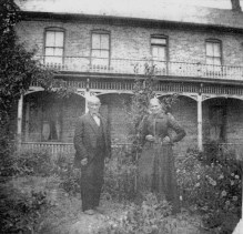 The Cardons in front of their brick house at 507 Washington Blvd.; their 1863 log cabin was replaced with a rock house in 1866 with this brick house in 1887.