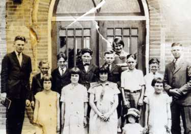 Ogden 15th Ward Sunday School class, c. 1923; row 2: ---, Don Sherner, --,--,--, Tug Anderson,---, ---(email us if you can identify anyone).