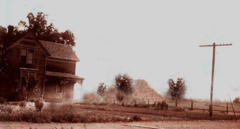 YESTERDAY: George Romrell house at 253 4th St and Clark's Hill in the background; photo courtesy Lee Romrell, circa 1910.