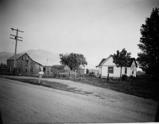 Robert E. Baird house at 2nd and 1000 West; the frame structure enclosed the original log cabin; demolished when Utah General Depot established; photo courtesy of Frank Layman.