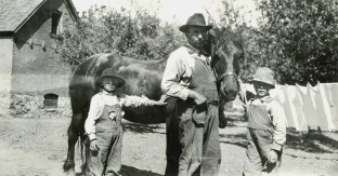Chauncey with sons Harvey and Warren; photo c. 1918.
