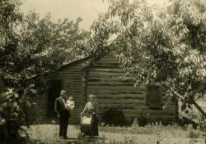 Chauncey Edna Kent Stone with baby Harvey by Bingham cabin where they lived 15 years; they rented the cabin for three years before buying the farm with Chauncey's brother John; photo 1911.