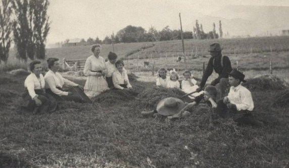 YESTERDAY: Petersen Farm at Madison and 3rd St. – L to R: Grandma Burnhope, Peter's wife Mary Ann Burnhope, Peter's sister Christine Petersen, two friends, Peter's daughter Helen, a friend, Peter's daughter Thelma, Peter Petersen, his son Frank, and a friend; photo circa 1910, courtesy Chris Petersen.