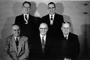 Robert Cunningham, Bishop Charles Wimmer, Earl E. Lee. Behind: Clifton Larsen, Brother Brady.